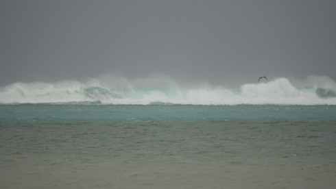 Waves already breaking over the reef 10 to 15 feet high, 800 yards out.