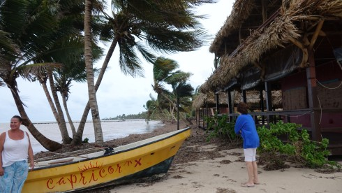 Falling coconuts can kill a person! Katie checking our Capricorn's boat